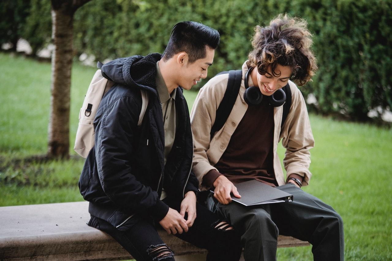 two people speaking - CollegeMarker