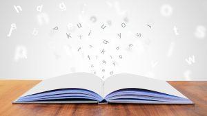 open book with alphabets - CollegeMarker