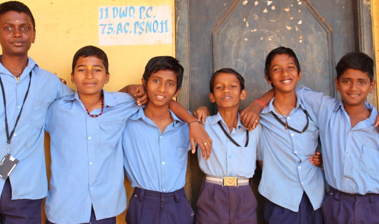 government school students standing together - CollegeMarker