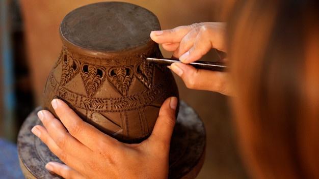 potter artist designing a pot - CollegeMarker