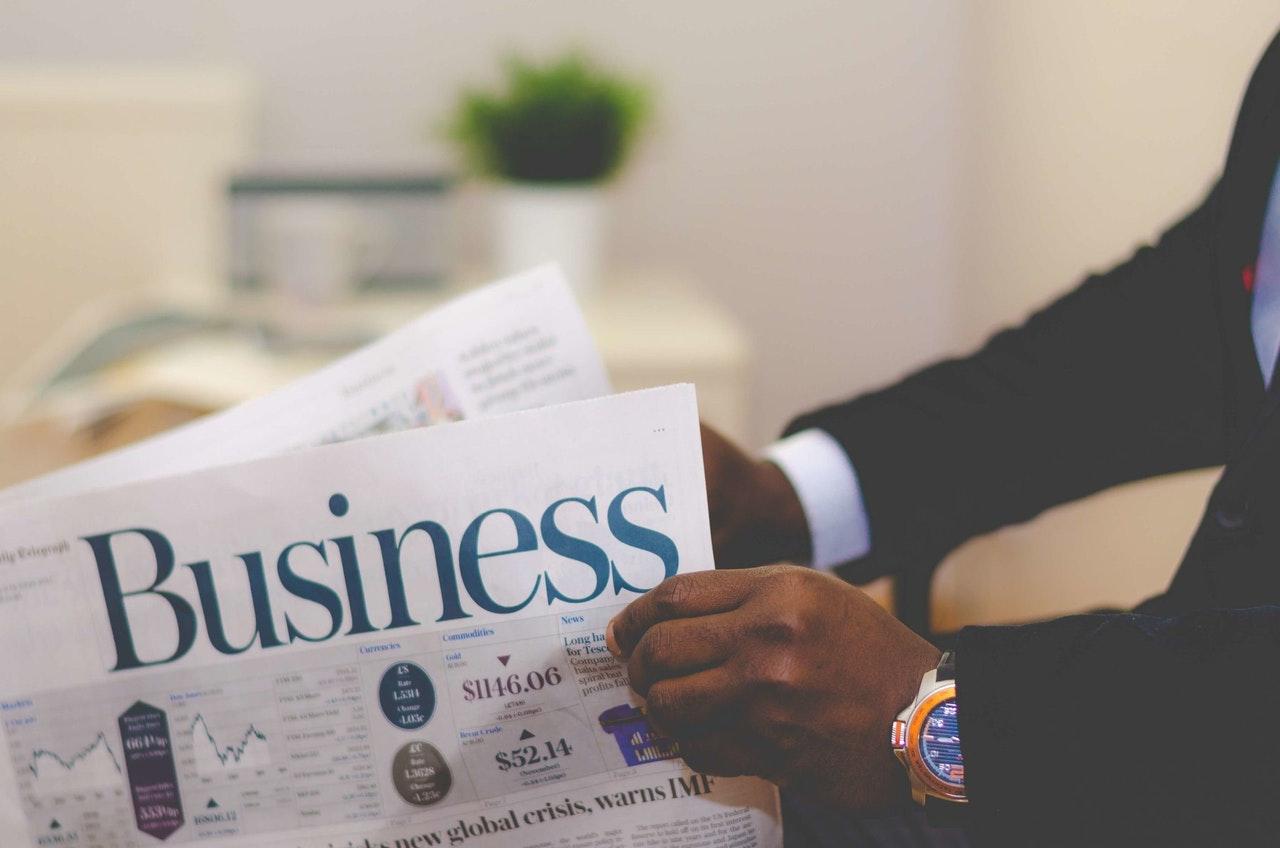 Business-man-reading-newspaper