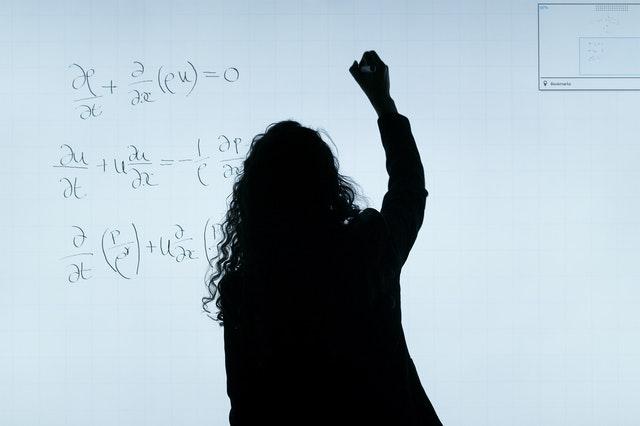 girl solving maths problem